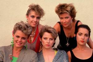 1984 --- The Go-Gos in 1984. Left to right, standing: Charlotte Caffey, Kathy Valentine; sitting: Belinda Carlisle, Gina Schock, Jane Wiedlin. --- Image by © Neal Preston/Corbis